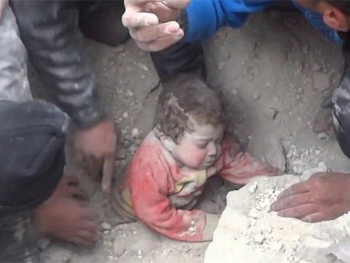 Child pulled out of rubble after air strike - Syria