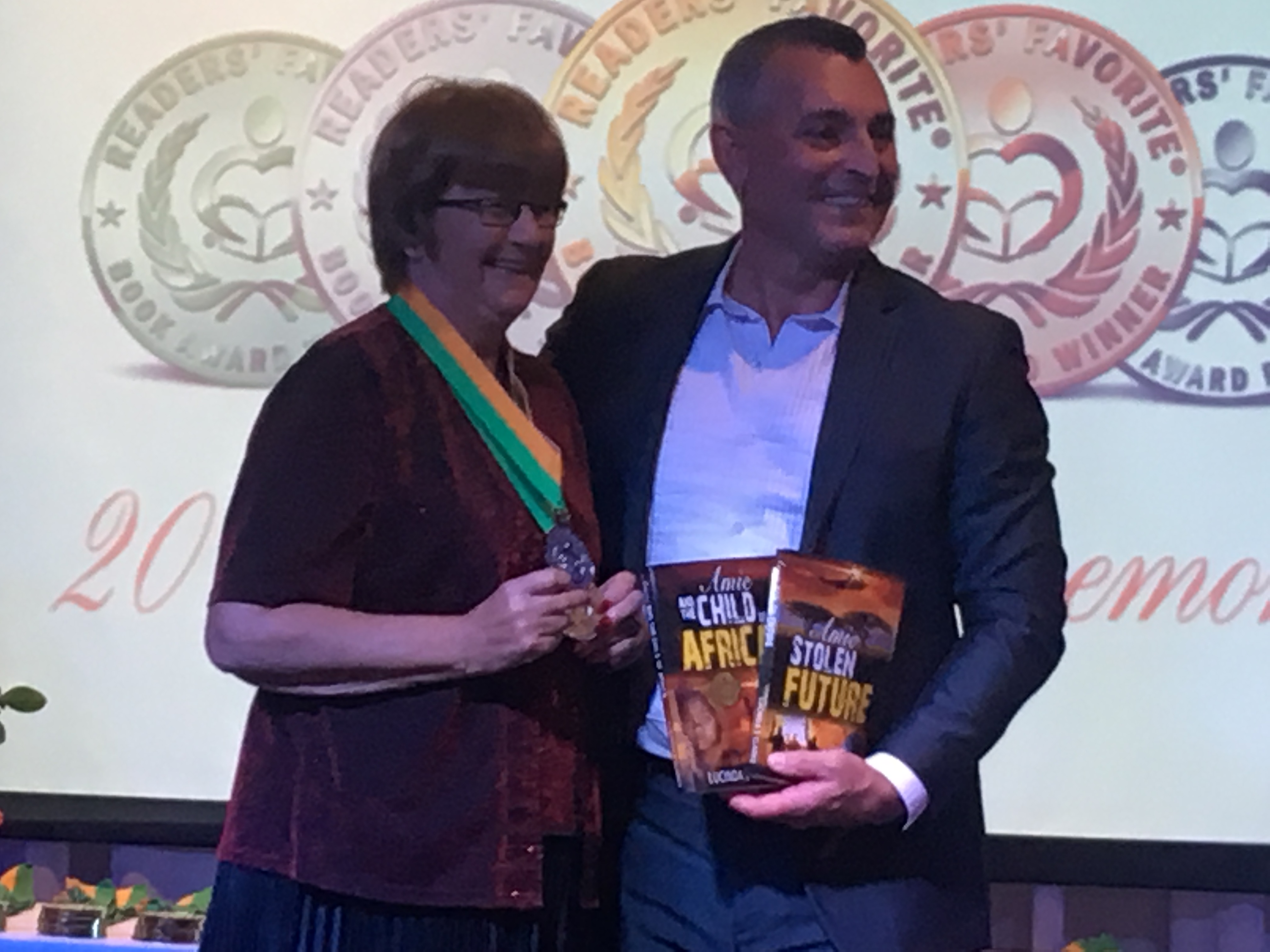 Image shows Lucinda with her medals and the award winning books