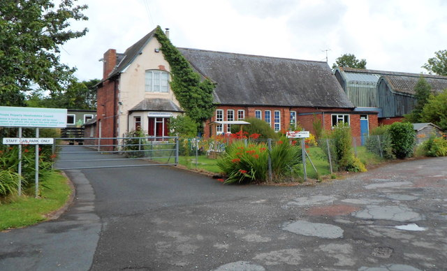 Image shows a fairly typical small Victorian school building