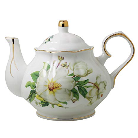 Image shows a rather ornate white bone china teapot with a large rose pattern on its side.
